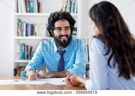 Arabic Businessman At Job Interview With Indian Trainee At Office
