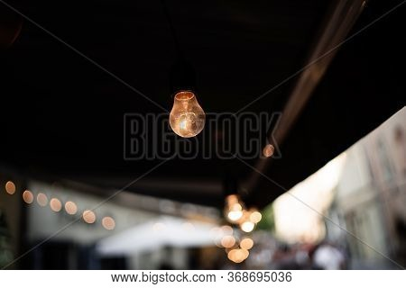 Idea Is Money Concept, Lighting Bulb In Dark Space. Luxury Interior Lighting. Light Bulb On Dark Bac