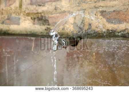 Outdoor Faucet And Running Or Leakage Water