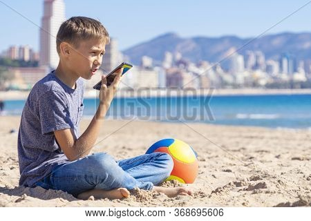 Teenager Boy Using A Smart Phone Voice Recognition Function Online, Using Cell Phone To Send A Voice