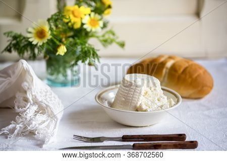 Fresh Italian Ricotta With Wheat Homemade Bread On The Table, Rustic Still Life Composition With Spr