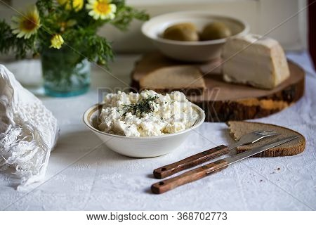 Fresh Italian Ricotta With Rye Homemade Bread And Lard On The Table, Rustic Still Life With Spring F