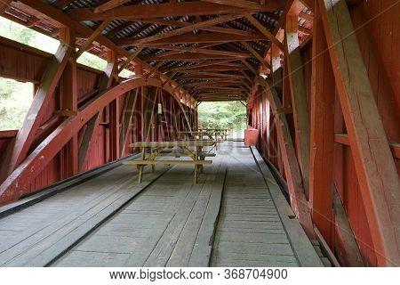 Interior Of The Josiah Hess Covered Bridge By Huntington Creek, In Fishing Creek Township, In Orange