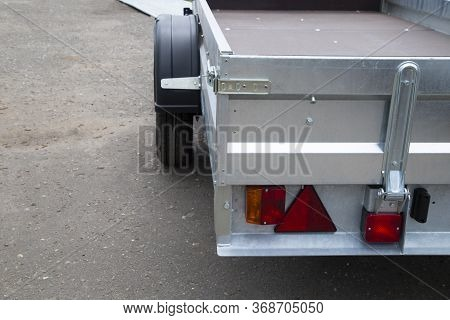 Car Open Trailer.a Store That Sells Car Trailers. Repair And Maintenance Of Trailers For Passenger C