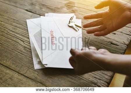Expressive Hands React To An Overdue Letter In An Envelope - Financial Hardship - Crisis