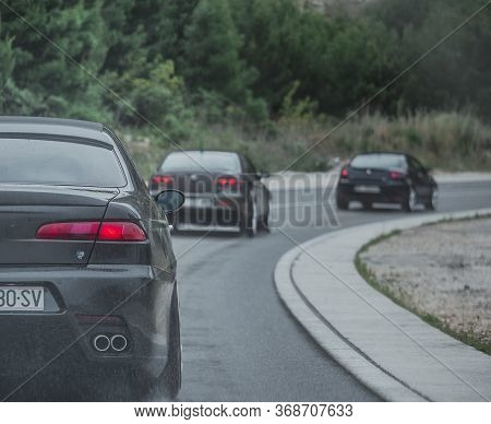 Blato,croatia May 2020 Multiple Alfa Romeos Driving In A Column. Enthusiasts Owners Meeting And Driv