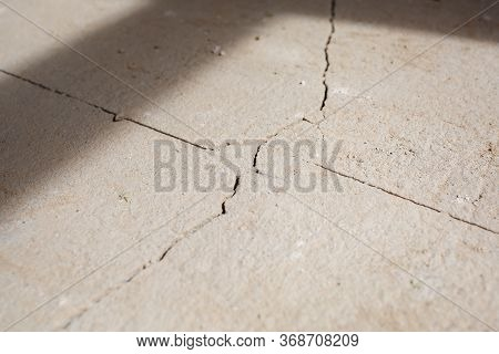 Cracks In The Concrete Cement Screed On The Floor After Repair. The Concrete Surface Texture Is Cove