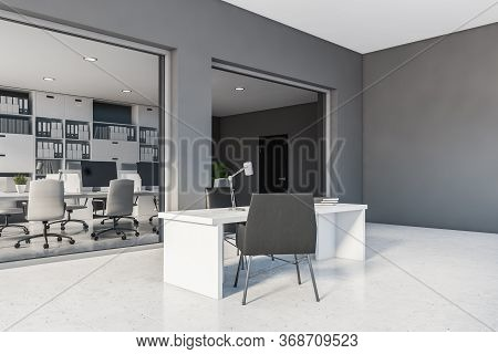 Corner Of Stylish Ceo Office With Gray Walls, Tiled Floor, Massive Table With Black Chairs And Open