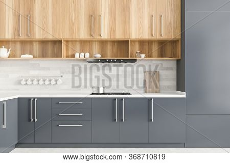Interior Of Modern Kitchen With Gray And White Walls, Grey Countertops And Wooden Cupboards. 3d Rend