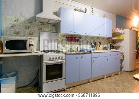 Outdated Kitchen Interior With A Hundred Finishes And A Simple Kitchen Set