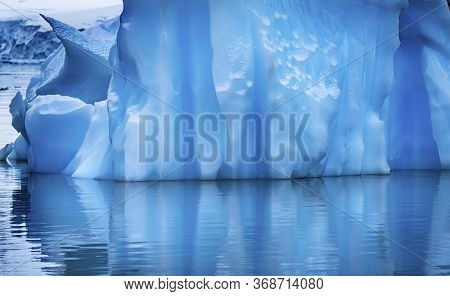 Floating Blue Iceberg Reflection Paradise Bay Skintorp Cove Antarctica. Glacier Ice Blue Because Air