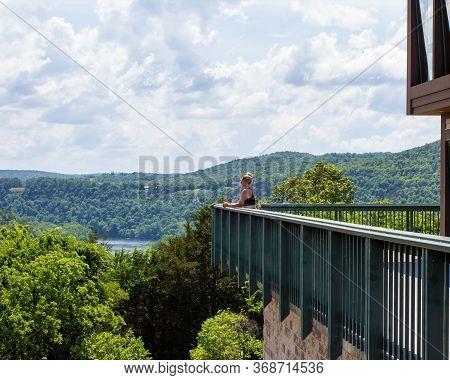 A Woman Overlooking The Dam In Bull Shoals Arkansas