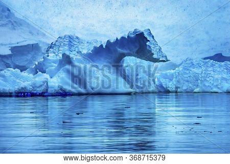 Snowing Floating Blue Iceberg Reflection Paradise Bay Skintorp Cove Antarctica. Glacier Ice Blue Bec
