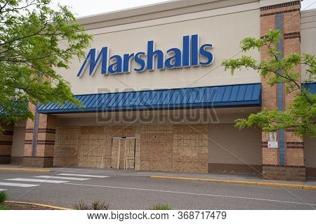 Minneapolis, Minnesota - May 29, 2020: A Marshalls Retail Store Is Boarded Up With Plywood In Preven