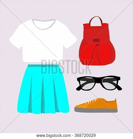 The Concept Of Casual Clothing For Girls. A Group Of Womens Items: A Turquoise Skirt, White T-shirt,