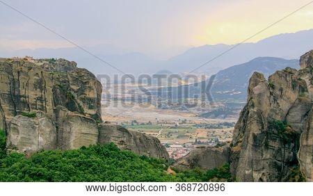 Monasteries Of Meteora Valley, At Sunset, Greece. The Monasteries Of Meteora Is Picturesque Religiou