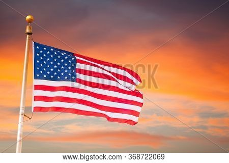 American Celebration- Usa Flag  American Flag On Flagpole Flying, Over A Beautiful And Colorful Suns