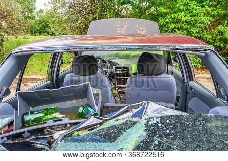 View Of Inside Of Destroyed Abandoned Car With Broken Car Glasses