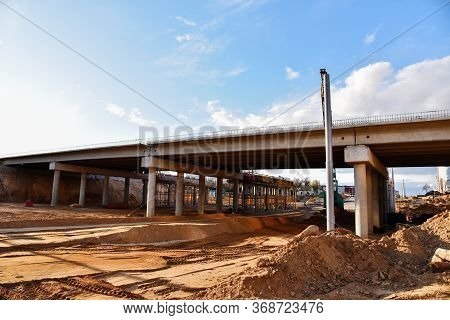 Roundabout And Traffic Bridge Construction. Construction Highway Ramps And Bridgeworks. Crane For Fo