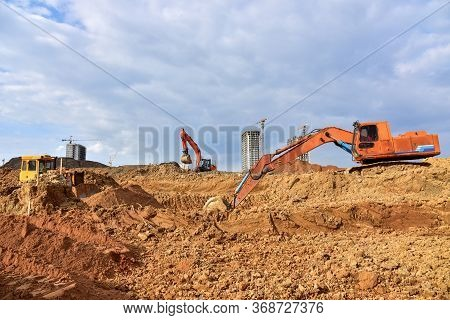 Bulldozer And Excavator For Earthworks At Construction Site. Earth-moving Equipment For Land Clearin