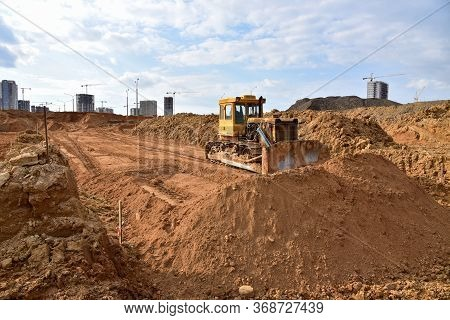 Dozer During Roadwork At Construction Site. Bulldozer For Land Clearing, Grading, Pool Excavation, U