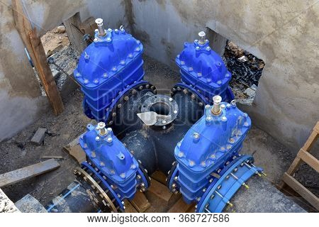 Resilient Seated Gate Valves Connect Pipeline Of Water Supply In Concrete Bunker At Constructin Site