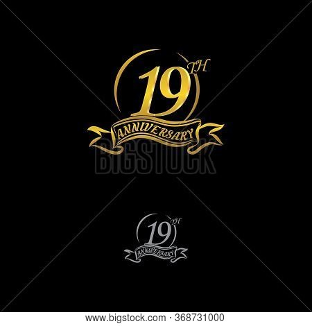 Celebrating The 19th Anniversary Logo, With Gold Rings And Gradation Ribbons Isolated On A Black Bac