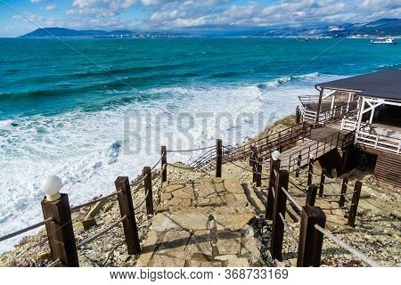 Cape Doob. The Storm And Waves Of The Bay Tsemess. Ships On The Roadstead Of Novorossiysk. A Stone S