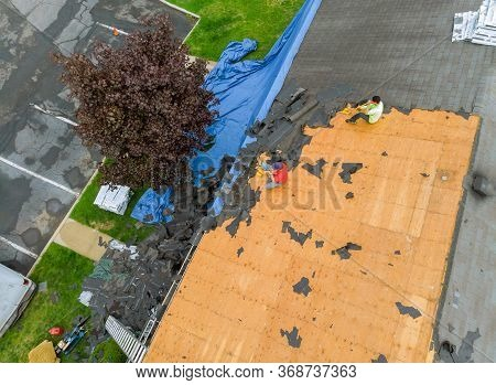 Remove Old Shingle Roof Layout And Applying New Shingles With Apartment