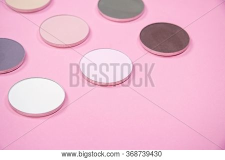 Pattern Of Eye Shadows Of Different Colors On A Pink Background