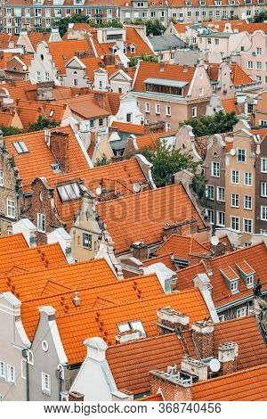 Top view of Gdansk old town with reddish tiled roofs of old town in Gdansk, Poland