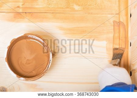 Close-up, Impregnation Of A Wooden Floor With Dark Varnish Manually, With A Brush, There Is A Place