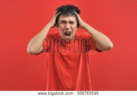 Screaming, Hate, Rage. Crying Emotional Angry Asian Man Screaming, Isolated On Red Background. Emoti