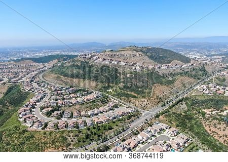 Aerial View Of Upper Middle Class Neighborhood With Big Villas Around Double Peak Park In San Marcos