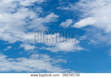 Beautiful Blue Sky With White Cloud. Fluffy Clouds Moving In The Wind On The Blue Sky.
