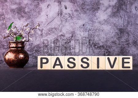 Word Passive Made With Wood Building Blocks On A Gray Background