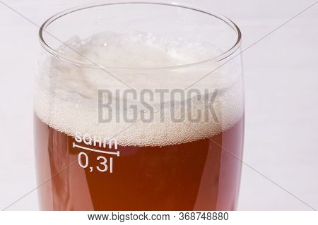 Beer Foam Glass Of Home Made Craft Beer From Light Malt  On White Background.  Ale Or Lager From Pil