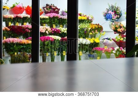 Many Flowers In A Flower Shop. Refrigerator With Flowers. Shop Fresh Bouquets. The Blurred Backgroun