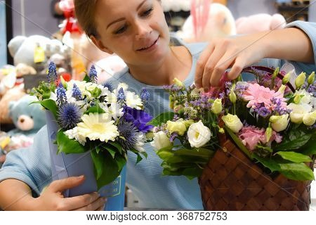 Florist Making A Floral Arrangement. Making Bouquet Of Fresh Flowers. The Woman In The Flower Shop.