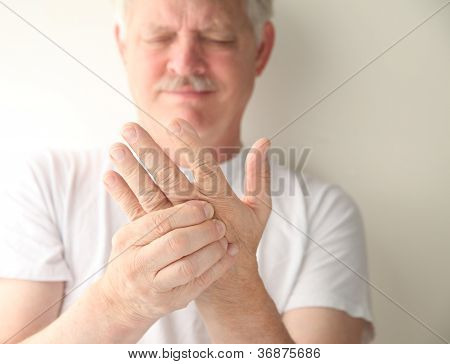 senior with numb hand
