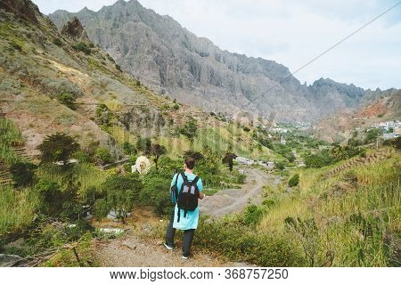 Santo Antao Cape Verde. Hiker With Backpack Going Down The Valley. Rocky Terrain Of High Mountain Ra