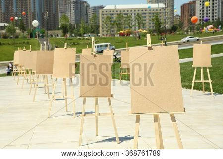 Wooden Easel With Blank Canvas . Pair Of Easel With Blank Canvas . Blank Art Board And Realistic Woo