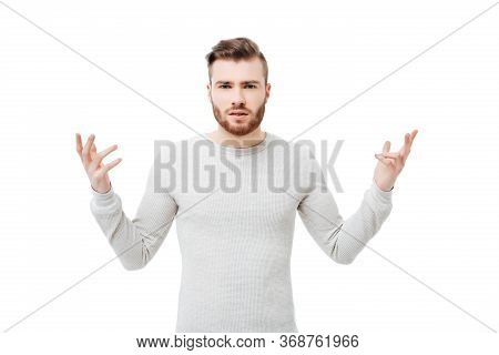 Embarrassed And Confused Bearded Young Man Showing Why Hand Gesture Over White Background