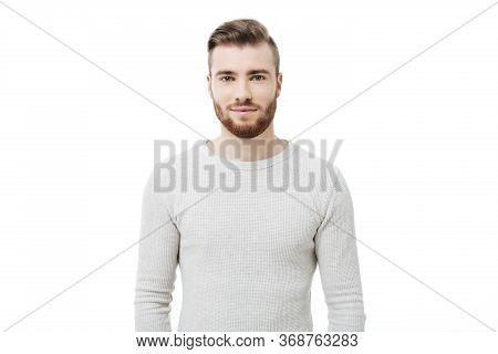 Portrait Of Young Handsome Man Looking At The Camera Over White Background. Attractive Bearded Guy I