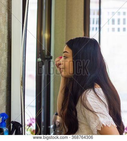 Young Woman Applying Mascara, Woman Applying Make Up, Woman Applying Make Up Near The Mirror