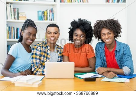 Group Photo Of African American And Latin Students At Computer At Classroom Of University