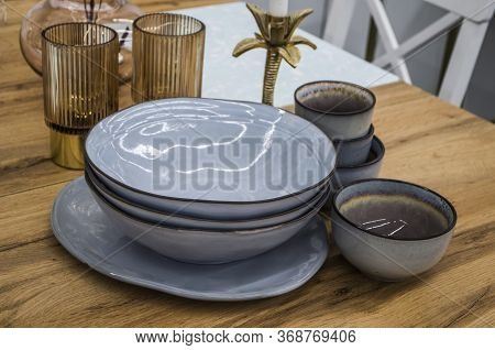 Still Life With Plates And Cups In The Style Of Hughes. Interior Photo.