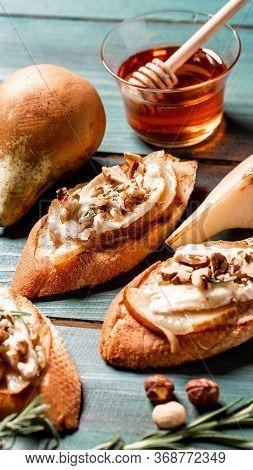 Pears And Brie Camembert Crostini. Selective Focus