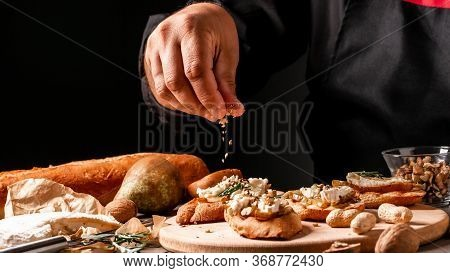 Appetizers Table With Italian Antipasti Snacks. Young Man Preparing Appetizer While Cooking In The K