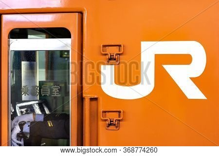 Osaka / Japan - November 10, 2017: Train Driver In The Cabin Of Japan Railways Train In Osaka, Japan